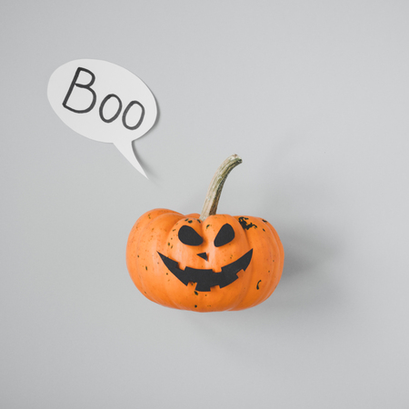 Happy halloween. Funny halloween pumpkin Jack o Lantern on gray background.