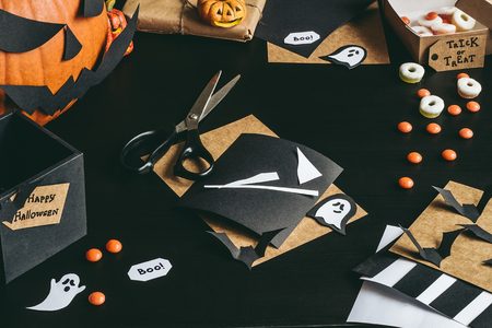 Halloween preparation. Halloween decoration made of craft paper. Stock Photo