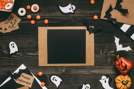 Halloween card with halloween decoration made of kraft paper. Copy space
