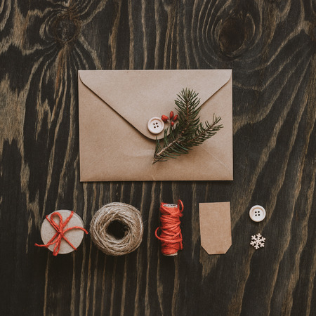 Christmas package. Christmas card, gift and christmas decoration on wooden table, top view.