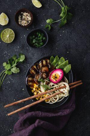 Ramen soup with noodles, vegetables and pickled egg.