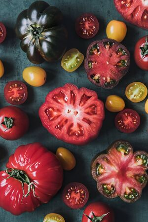 Colourful juicy food background. Fresh juicy tomatoes on background close up. 스톡 콘텐츠