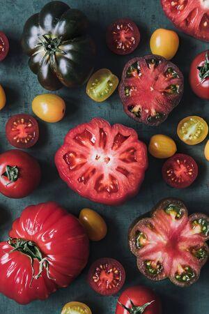 Fresh juicy tomatoes on background, close up.