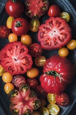 Fresh juicy tomatoes on plate, view from above