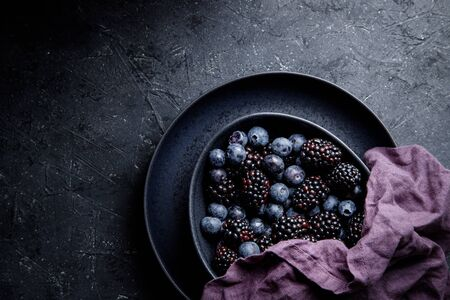 Fresh summer berries in bowl close up.