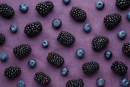 Berry pattern background. Fresh juicy blackberries and blueberries