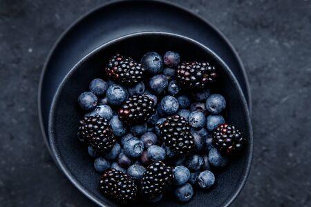 Fresh juicy blackberries and blueberries close up