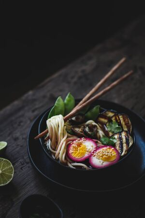 Ramen noodle soup with vegetables and pickled egg, close up. 스톡 콘텐츠