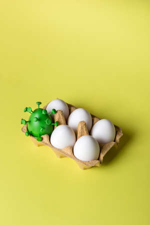 Easter eggs with one green egg decorated . Easter creative concept