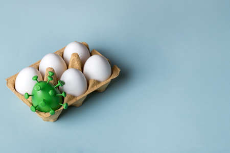 Easter eggs with a green egg decorated . Easter creative concept