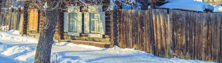 The windows of the old wooden house in the winter Stock Photo