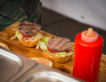 cooking burger on the street close up