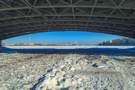 a view of the Peter and Paul Fortress from under the Palace Bridge in St. Petersburg in the winter