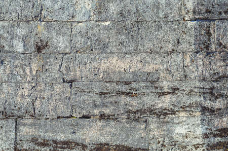 the old grey stone wall close up