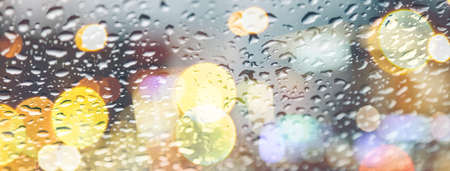 raindrops on the glass with lights close-up