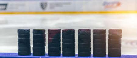 ice hockey pucks close up on ice