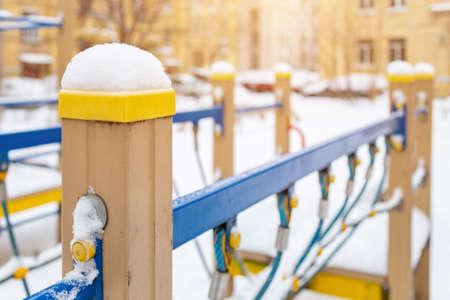 Children's playground under the snow close up