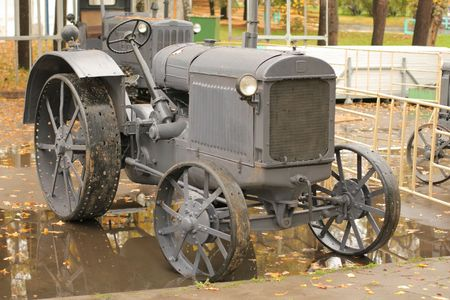 rarity: Old rarity tractor in autumn and its reflection Stock Photo