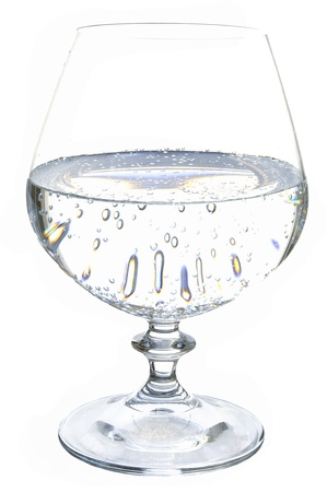 freshening: Mineral sparkling water in a glass on the white isolated background Stock Photo