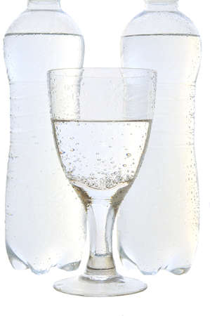 viability: Mineral water in a glass and bottles on the white isolated background