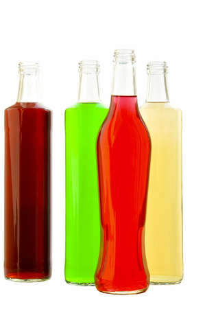 Bottles glass with multi-colored lemonade on the white isolated background