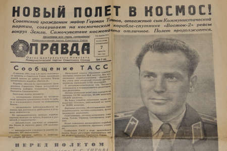 manned: MOSCOW, USSR - AUGUST 7  Front page of the Soviet newspaper  Pravda  with reporting about second soviet manned flight in Space and portrait of the astronaut German Titov  Flight was on August 6-7, 1961