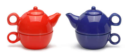 Sets of blue and red ceramic teapots and mugs isolated on a white background. photo