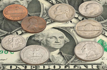 United states coins on one dollar bills. photo