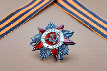 may 9: Soviet military order and George ribbon - symbols of the Victory Day in WWII on May 9