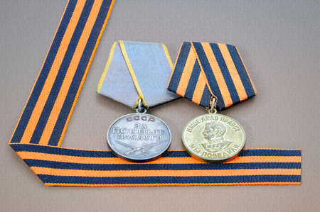 may 9: Soviet military medals and George ribbon - symbols of the Victory Day in WWII on May 9