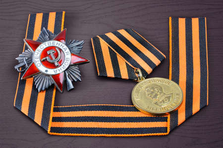 may 9: Soviet military medal in honor of a victory in war against Germany 1941-1945, Soviet military order, George ribbon - symbols of the Victory Day in WWII on May 9 Editorial