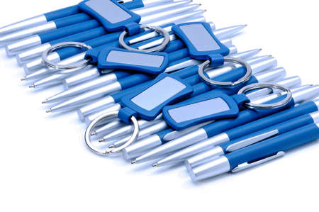 keychains: Silver-blue metal pens and keychains isolated on white background. Stock Photo