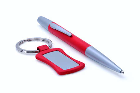 bibelot: Silver-red metal pen and keychain isolated on white background.