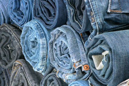 bluejeans: Stack of rolled colored jeans. Side view.