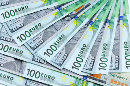 us dollars: Banknotes of 100 US dollars and 100 euro are around one on another as a background Stock Photo