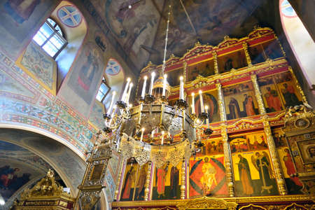 iconostasis: Interior of Russian Orthodox Church. A view of an iconostasis walls and a ceiling with frescos and a suspended chandelier. Editorial