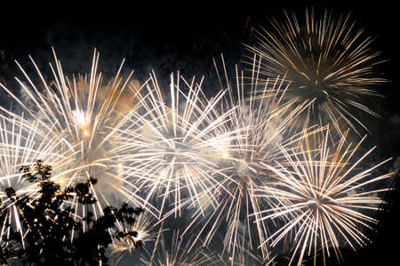 glow pyrotechnics: Flashes of white salute fireworks against the black sky Stock Photo