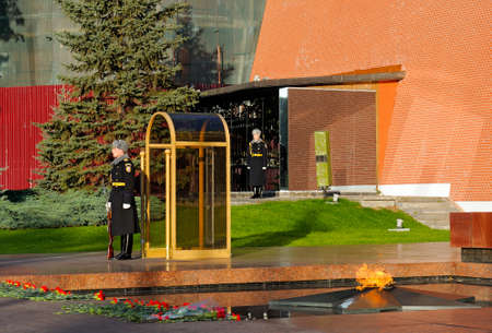 tomb of the unknown soldier: MOSCOW. RUSSIA - OCTOBER 16, 2015: Soldiers of the Presidents regiment near Tomb of Unknown soldier and Eternal flame in Alexander garden against a wall of the Kremlin.