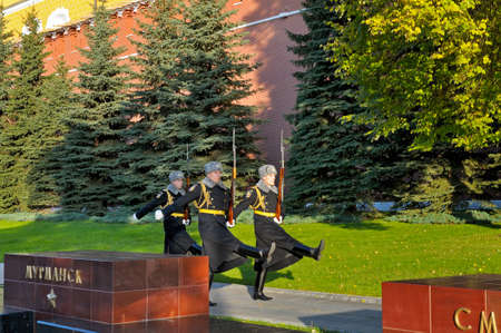 returned: MOSCOW. RUSSIA - OCTOBER 16, 2015: Soldiers of the Presidents regiment returned to the barracks after the change of the guard of honor near the grave of the Unknown Soldier and the eternal flame in the Alexander Garden near the Kremlin