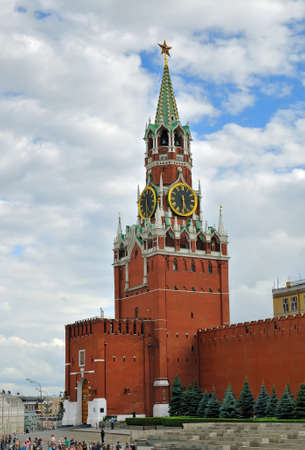 spassky: Moscow, Russia - on July 23, 2013: Spasskaya Tower of the Moscow Kremlin and tourists on Red Square go sightseeing in Moscow