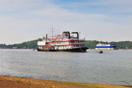 steamboat: Old steamboat in the foreground and the modern motor ship behind it are moored on the river