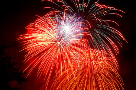 glow pyrotechnics: Colorful fireworks on the black sky background.