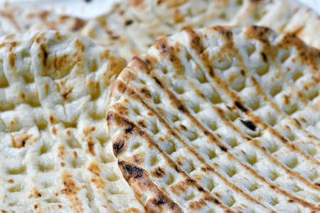 matzah: Unleavened cake like matzah. Macro shooting. Stock Photo