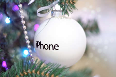 MOSCOW, Russia - December 12, 2014: Christmas ball with the iPhone logo on the Christmas tree, located in Moscows largest department store called GUM. Editorial