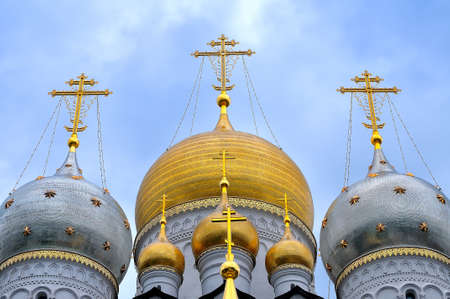 the orthodox church: Domes of Russian Orthodox Church with crosses against the background of the blue sky. Stock Photo