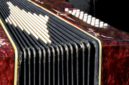 Old musical instrument Russian bayan - button accordion close up