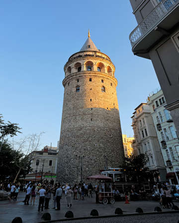 ISTANBUL, TURKEY - SEPTEMBER 17, 2016: Evening view of the Galata Tower - one of the famous landmarks of Istanbul and surrounding buildings