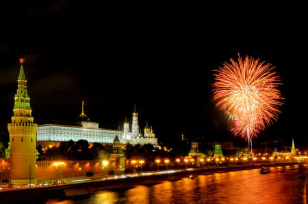 gloaming: Flashes of orange and white fireworks over the Moskva river near Moscow Kremlin
