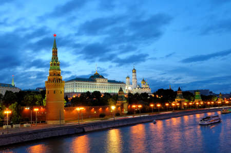 Evening view of Moscow Kremlin, Moscow river embankment and boat sailing along the Moskva river