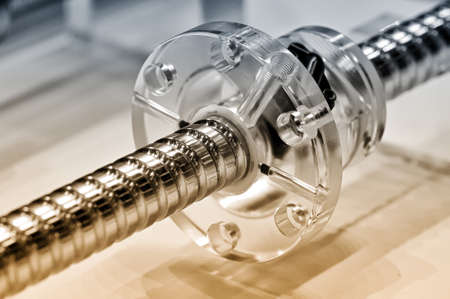worm gear: Steel rod with a screw thread and a plastic round detail. Selective toning, small depth of field. Close up Stock Photo